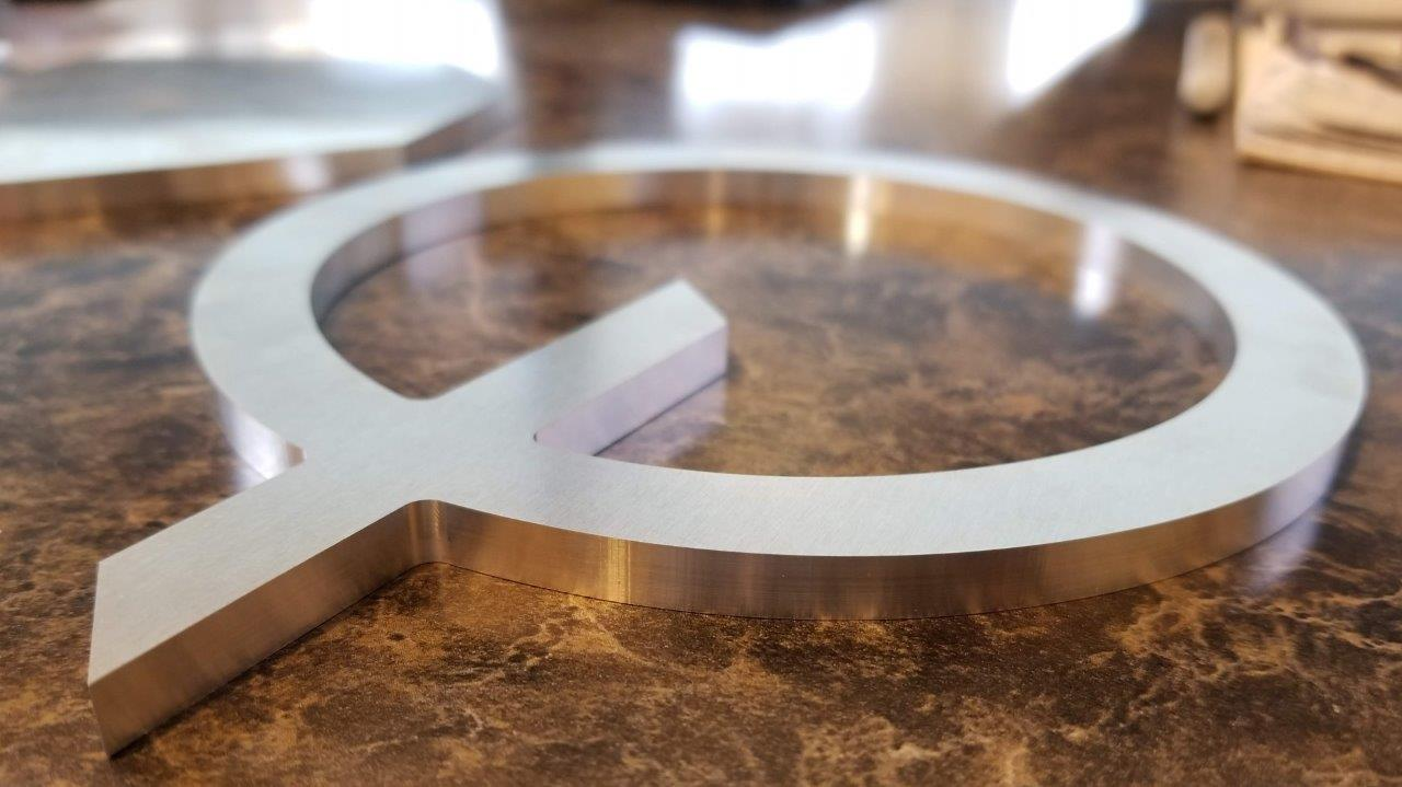 CNC machined aluminum letter